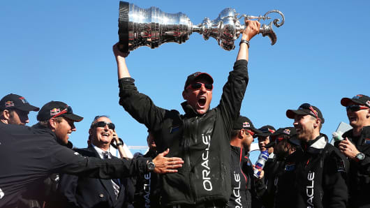 Oracle Team USA skippered by James Spithill celebrates after beating Emirates Team New Zealand to defend the America's Cup on September 25, 2013 in San Francisco, California.