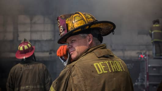 Members of the Detroit Fire Department fight a two-alarm fire that broke out in an abandoned building. Detroit has an estimated 78,000 abandoned buildings across its 142 square miles.