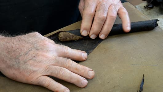 A cigar roller works in the Little Havana area of Miami.