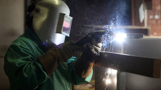 A worker welds an aluminum case at the Aluminum Case Company, a division of MFZ Ventures, Inc., a privately held company established in 1946 that designs, engineers, and manufactures various types of aluminum cases, in Chicago.