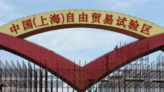 An archway posted with the sign of China (Shanghai) Pilot Free Trade Zone is surrounded by scaffolding in Shanghai.