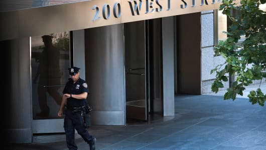 A New York City Police Department officer passes in front of Goldman Sachs Group headquarters.