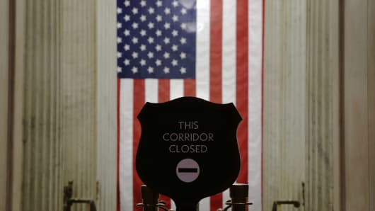 A sign marks a closed corridor at the Rotunda of the U.S. Capitol September 30, 2013 on Capitol Hill in Washington, DC.