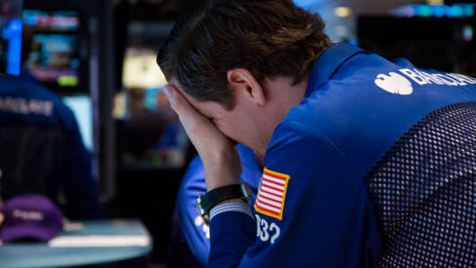 A trader works the floor of the NYSE.