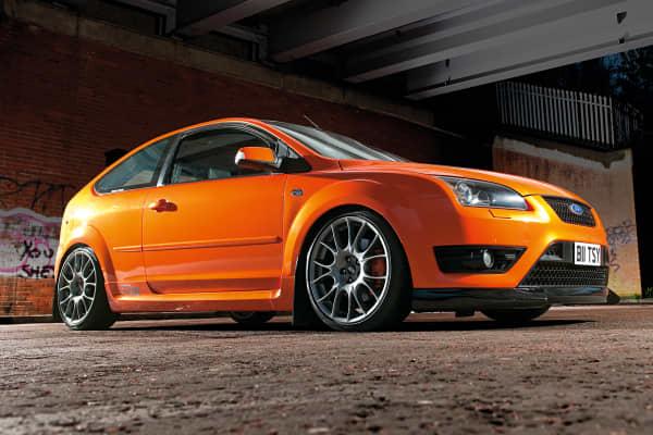 Portrait of a customised Ford Focus ST in Lamborghini Electric Orange.
