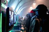 People try Activision Blizzard Inc.'s 'Call of Duty: Modern Warfare 3' on Microsoft Corp. XBox 360 video game consoles.