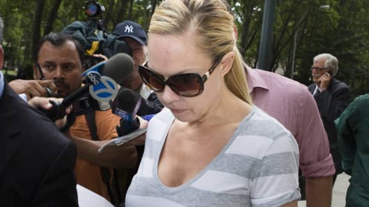 Andrea Sanderlin, a New York mom who allegedly ran a $3 million marijuana operation out of a New York City warehouse, leaves federal court in July after making bail.