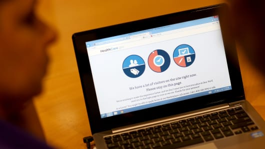 A message is seen on the computer indicating that there are too many visitors on the Affordable Care Act site to continue.