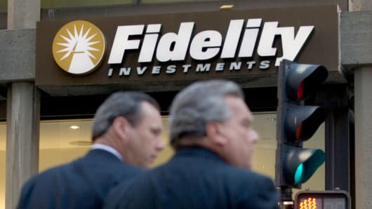 Pedestrians pass a Fidelity Investments office in Boston, Massachusetts.