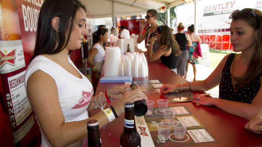 A Budweiser bartender serves up samples of Brewmaster's Project Twelve.