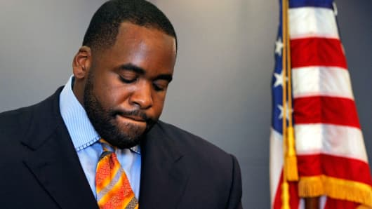Detroit Mayor Kwame Kilpatrick reads a statement September 4, 2008 at his office in Detroit, Michigan.