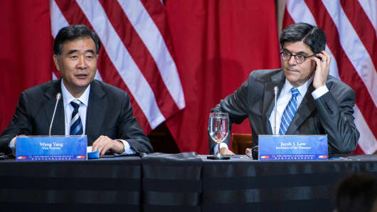 US Secretary of the Treasury Jack Lew listen while Chinese Vice Premier Wang Yang during the closing session of the 5th United States and China Strategic and Economic Dialogue.