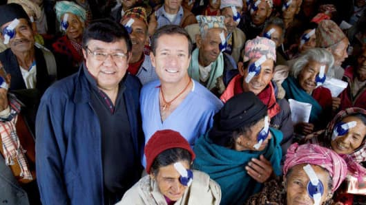Dr. Sanduk Ruit and Dr. Geoffrey Tabin with patients of the Himalayan Cataract Project