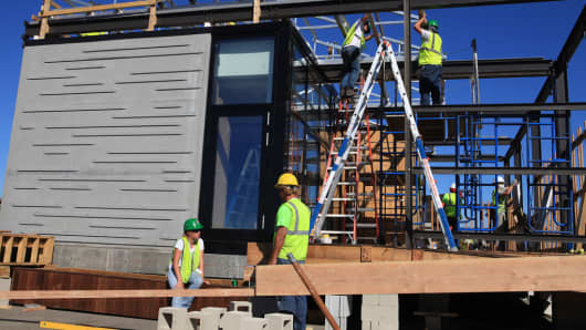Construction on one of the home of the future during the Department of Energy's annual Solar Decathlon competition.