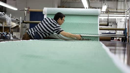 A worker cuts fabric patterns at Dynotex Inc. garment factory in the Brooklyn borough of New York.