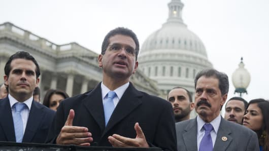 File Photo: Resident Commissioner Pedro Pierluisi (C) of Puerto Rico speaks alongside U.S. Rep. Jose Serrano (R), Democrat of New York, and Puerto Rican activists.