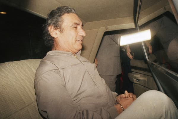 New Jersey state senator, David Friedland, is ushered to a car while in the custody of federal marshals at Kennedy International Airport in New York Sunday, Dec. 28, 1987.