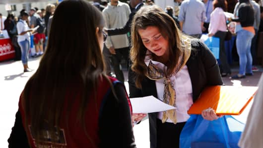 A woman receives information about job opportunities with Lowe's Cos. during the Fall Classic Hiring Spree event at Los Angeles City College in Los Angeles.