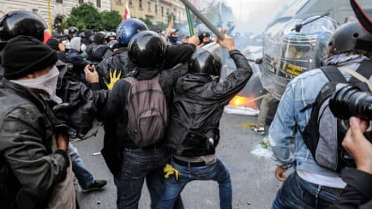 Clashes between police and demonstrators on October 19 in Rome, Italy