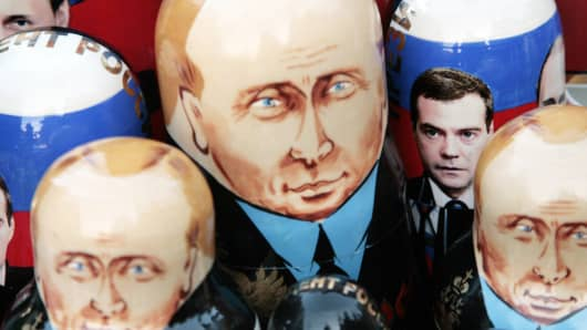 Traditional nesting dolls feature the faces of Vladimir Putin and Dmitry Medvedev.
