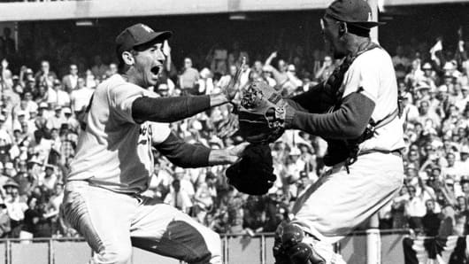 Pitcher Sandy Koufax, left, and catcher John Roseboro celebrate in Los Angeles on Oct. 6,1963, after the Los Angeles Dodgers beat the New York Yankees 2-1 to take the 1963 World Series in four straight games.