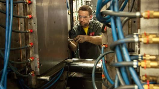 Operator specialist Joel Klawiter sets a new mold in an injection molding machine at the Miller Felpax Corp. rail parts manufacturing facility in Winona, Minnesota.