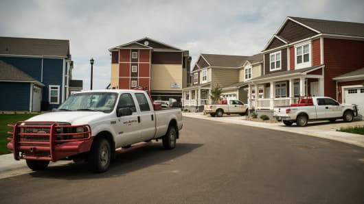 Trucks are parked near new homes rented by oil workers on July 28, 2013 in Williston, North Dakota.
