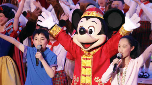 File photo: Entertainers perform during the ground breaking ceremony for the Walt Disney Co. Shanghai Disney Resort in Shanghai, China.