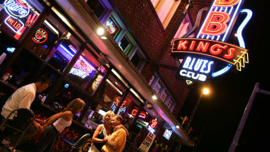 Revellers outside BB King's Blues Club on Beale Street in Memphis, Tennessee where open containers of alcohol in the entertainment district is permitted.