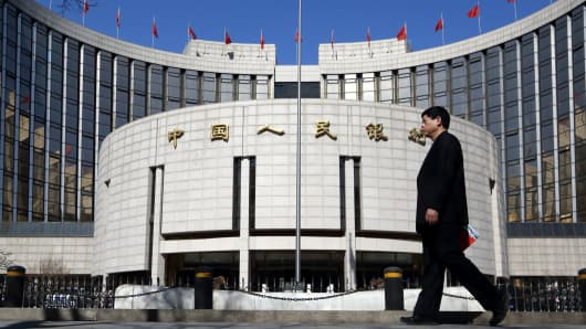 A man walks past the People's Bank of China headquarters in Beijing.