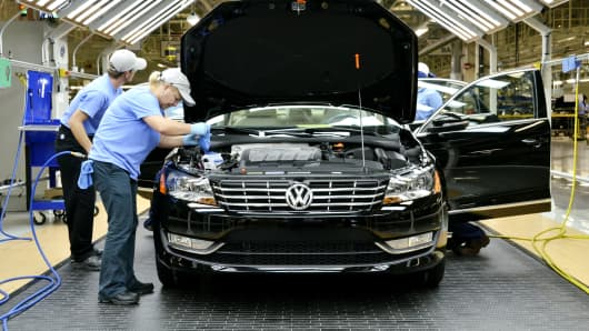 Workers inspect a Passat at the Volkswagen Chattanooga plant in Tennessee.