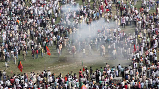People seen rushing after six serial bomb blasts took place at the venue of Narendra Modi's Hunkar rally near Gandhi Maidan on October 27, 2013 in Patna, India.