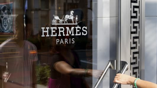 A woman enters the Hermes International store on Rodeo Drive in Beverly Hills, Calif.
