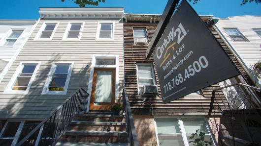 A Century 21 Real Estate LLC 'For Sale' sign hangs in front of a property in the Park Slope neighborhood of Brooklyn.