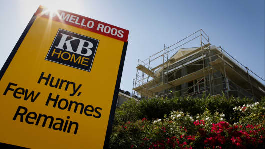 A KB Home sign stands in front of a house under construction at the Whisler Ridge housing community in Lake Forest, California