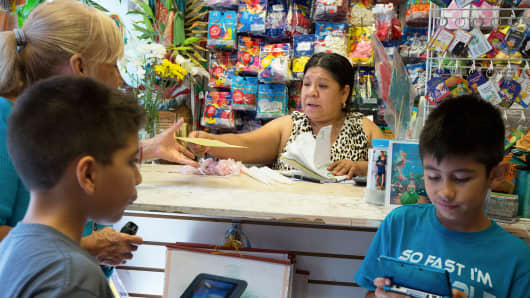 Guadalupe Perez, who took a loan from Grameen America, a leader in microlending, at the store in New York.