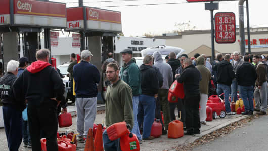 In the aftermath of Superstorm Sandy, patrons wait in line for gas in Seaford, N.Y.