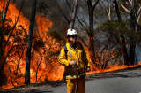 A firefighter monitors a back burn near Mount Victoria in the Blue Mountain, Australia.