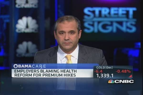 Employers blame health reform or premium hikes