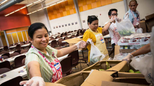 Volunteers help bag to-go meals at Cathedral Kitchen in Camden, NJ.