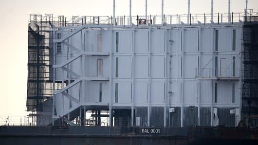 Mystery barges with construction of shipping containers have appeared in San Francisco and Portland, Maine, prompting online rumors that the barges are affiliated with a Google project.
