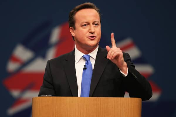 British Prime Minister David Cameron delivers his keynote speech at Manchester Central on October 2, 2013 in Manchester, England.