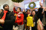 People rush into Macy's in New York as it opens at midnight on Nov. 23, 2012 to start the Black Friday shopping weekend.