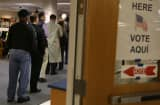 Voters line up Tuesday Spring Hill Elementary School in McLean, Va.