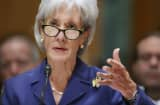 Health and Human Services Secretary Kathleen Sebelius answers questions about the error-plagued launch of Healthcare.gov while testifying before the Senate Finance Committee in the Dirksen Senate Office Building on Capitol Hill.