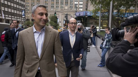 Mike Gupta, chief financial officer of Twitter Inc., left, and Richard 'Dick' Costolo, chief executive officer of Twitter Inc., center, arrive at JPMorgan Chase & Co. headquarters in New York.