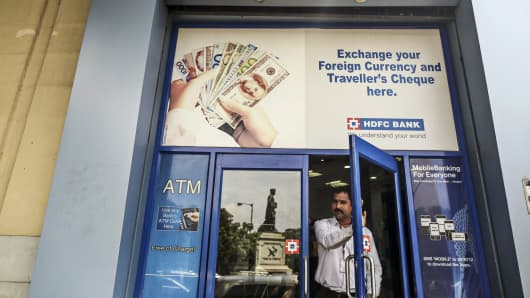 A man exits a HDFC Bank branch in Mumbai, India.