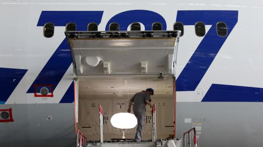 An engineer works on a Boeing Co. 787 Dreamliner aircraft