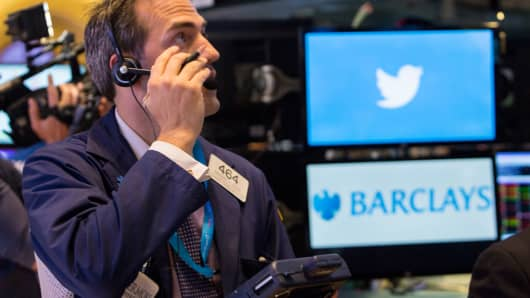 A trader watches Twitter stock at the closing bell the day of its IPO.