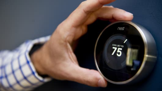 Thermostat by Nest Labs tracks your heating patterns and logs them into it's memory to adjust automatically.